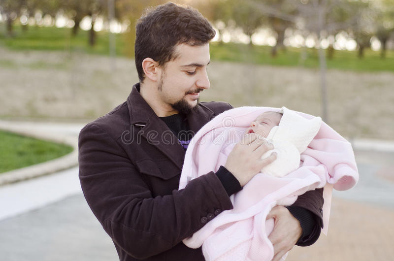 Father love. Father and newborn baby in a park stock photography