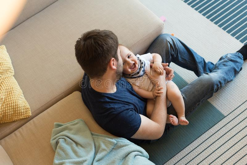 Father playing with baby royalty free stock images
