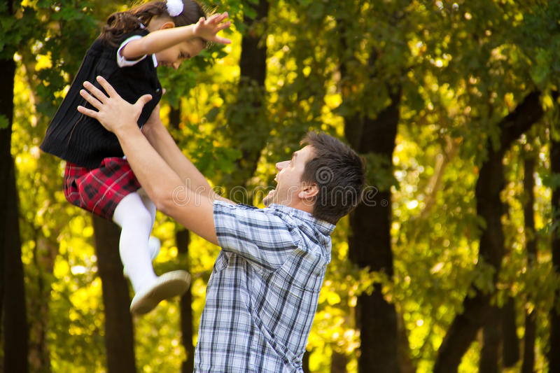 Download Father Playing With Daughter Stock Photo - Image of delighted, midair: 21536176