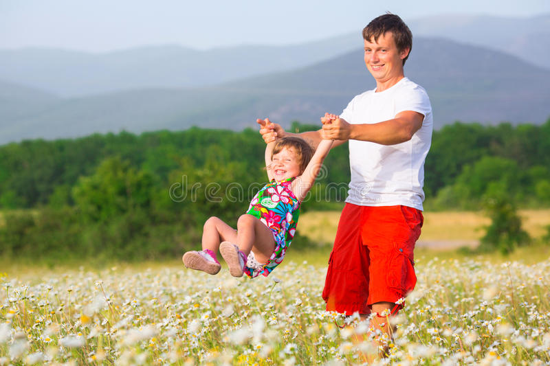 Father playing with daughter royalty free stock photography