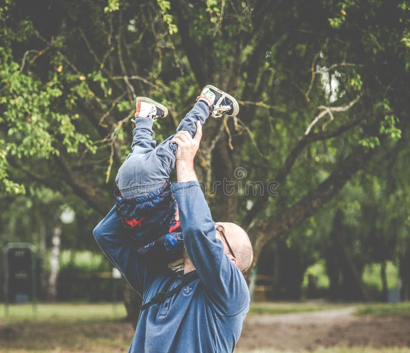 Father playing with his kid royalty free stock photo