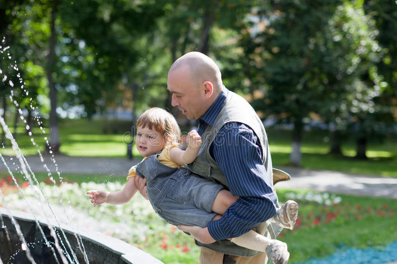 Father plays with 2 years baby stock photography