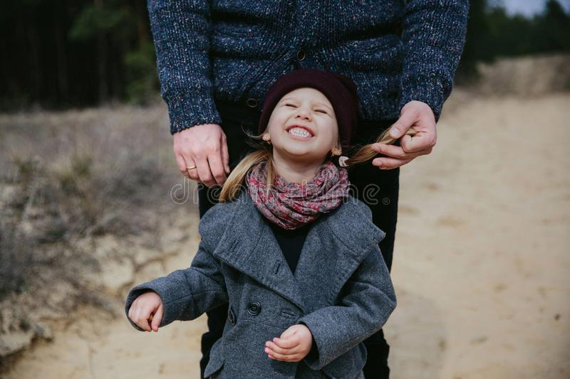 Father plays with his daughter in autumn stock photography