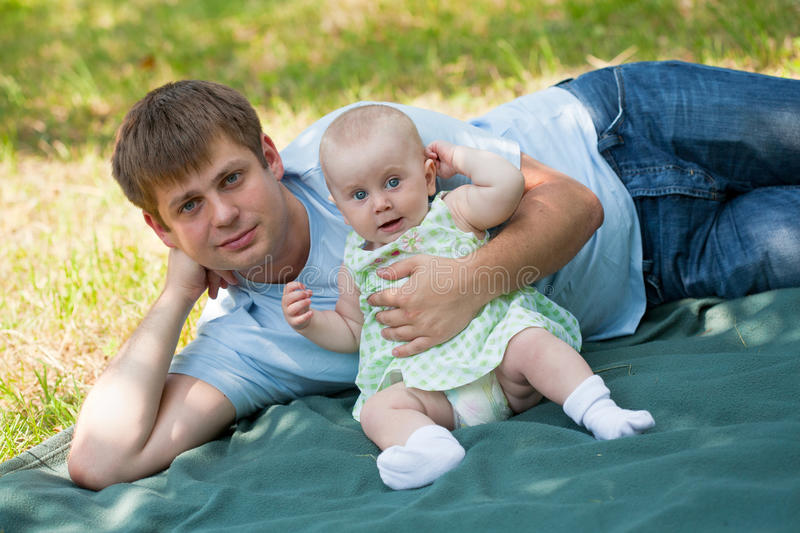 Father plays with the small daughter stock photos