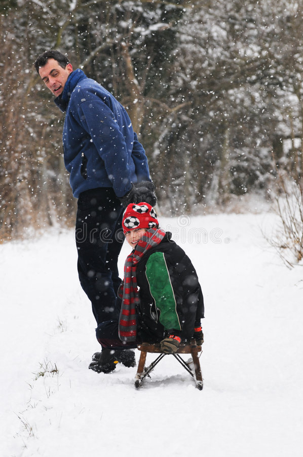 Download Father Pulling Son On Sledge Stock Photo - Image of sledge, excitement: 8138546