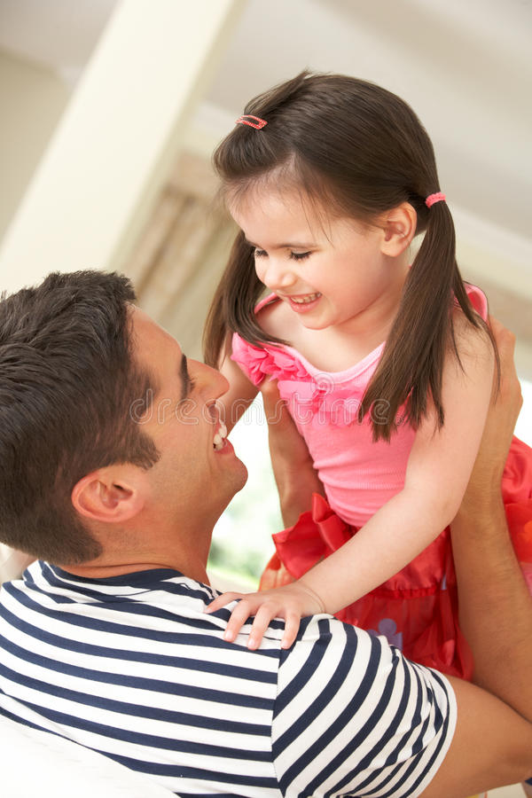 Father Relaxing At Home With Daughter Royalty Free Stock Photo