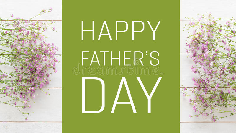 Father`s day background. White wooden table with pink flowers royalty free stock photos