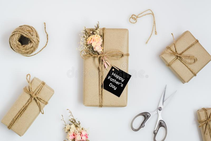 Father`s day concept. DIY hand mand Fathers Day gifts with tag Happy Father`s Day with beautiful natural flower bouquet on white royalty free stock image