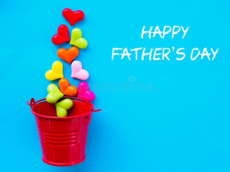 Father`s day concept. HAPPY FATHER`S DAY text with colorful heart and gift on blue background.  stock photos