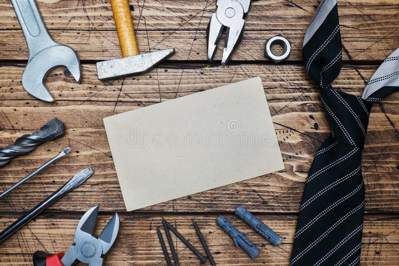 Father`s Day Concept. Tie and tools for repair and construction. Wooden background. Copy space stock photo
