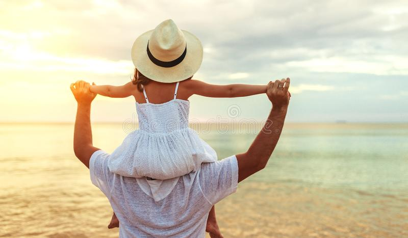 Father`s day. Dad and child daughter playing together outdoors on a summer. Beach royalty free stock photos