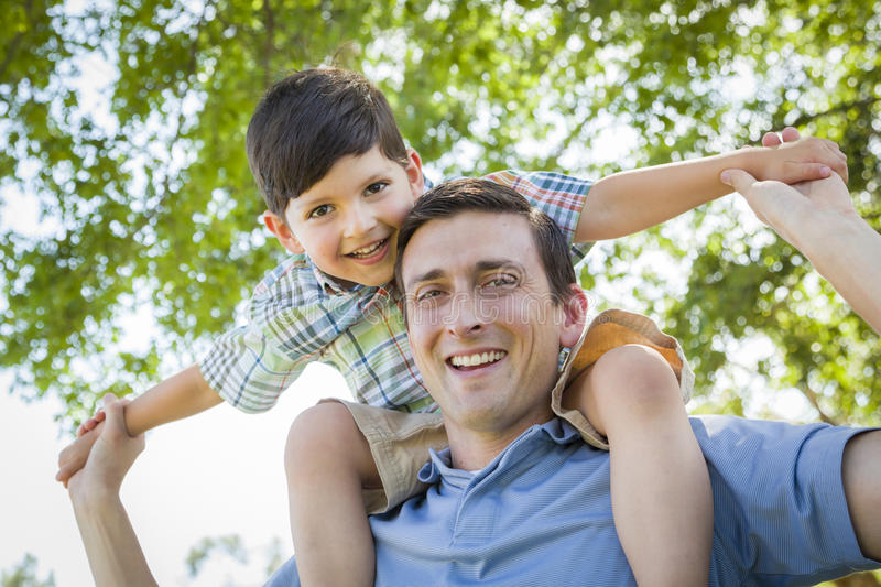 Father's Day Fun - Son Rides Piggyback with his Dad royalty free stock images