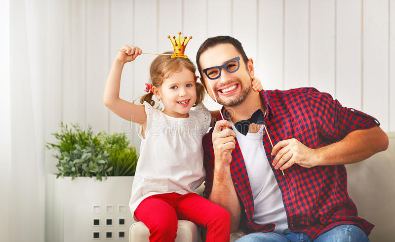 Father`s day. Happy family daughter in crown hugging dad and lau. Ghs on holiday stock image