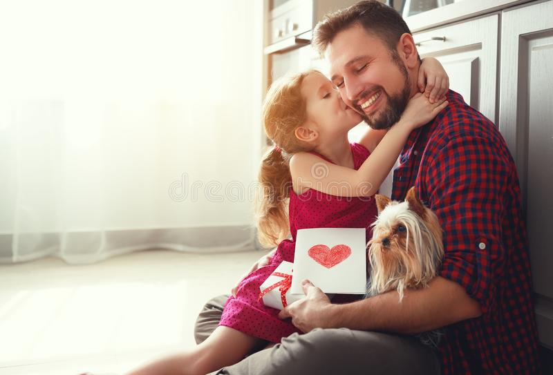 Father`s day. Happy family daughter giving dad greeting card stock images