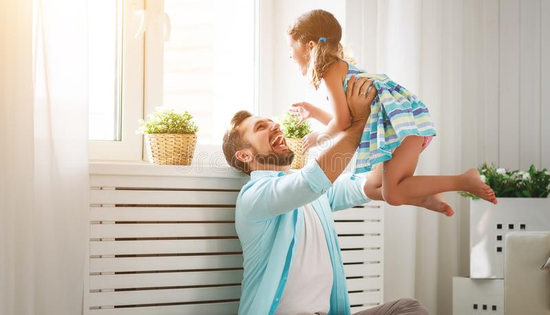 Father`s day. Happy family daughter hugging dad and laughs stock photos