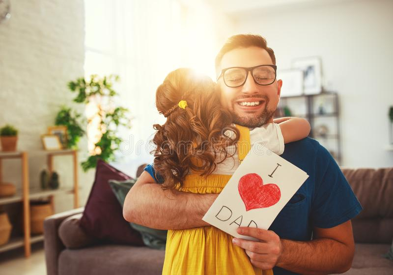 Father`s day. Happy family daughter hugging dad and laughs stock photography