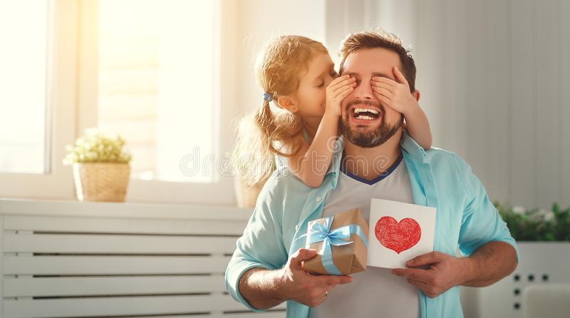 Father`s day. Happy family daughter hugging dad and laughs stock photo