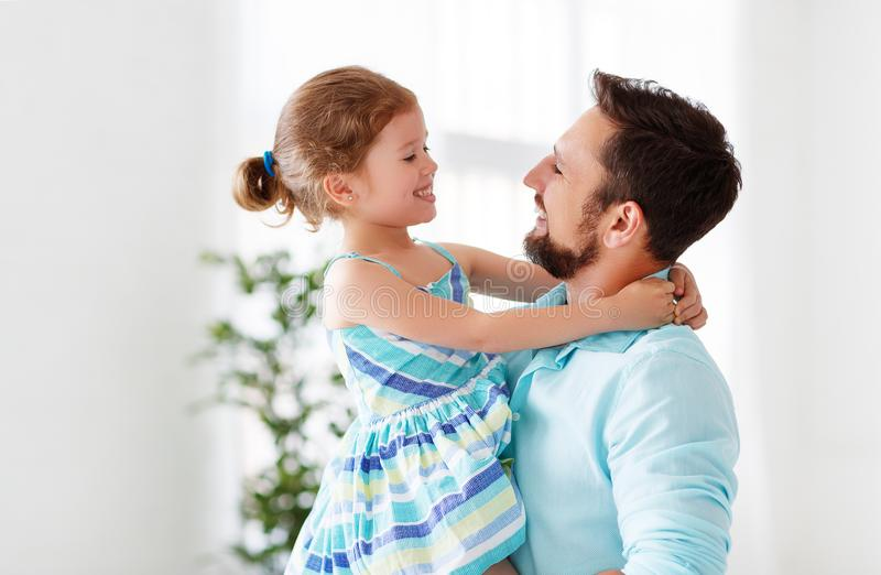 Father`s day. Happy family daughter hugging dad and laughs. On holiday royalty free stock photography