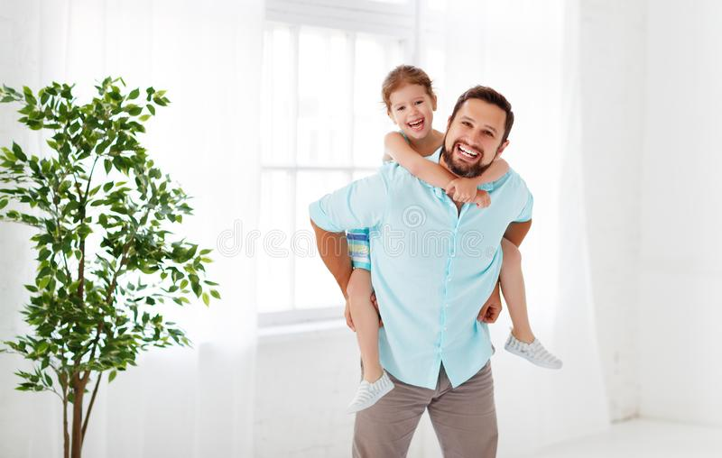 Father`s day. Happy family daughter hugging dad and laughs. On holiday royalty free stock image