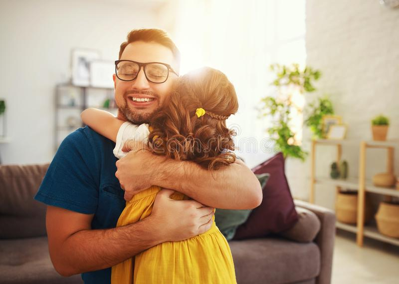 Father`s day. Happy family daughter hugs his dad stock images