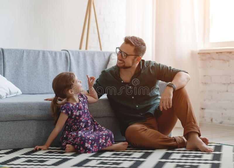 Father`s day. Happy family daughter hugs his dad. On holiday royalty free stock image