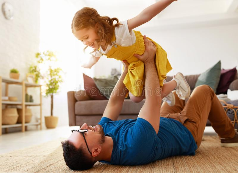Father`s day. Happy family daughter hugs his dad. On holiday stock photography