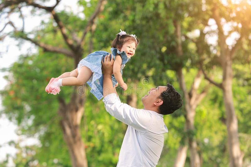 Father`s day. Happy joyful father having fun throws up in the ai stock image