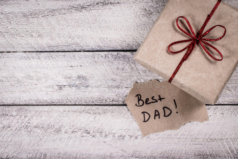 Father`s day. Holiday. greeting card. present gift box on wooden background royalty free stock images