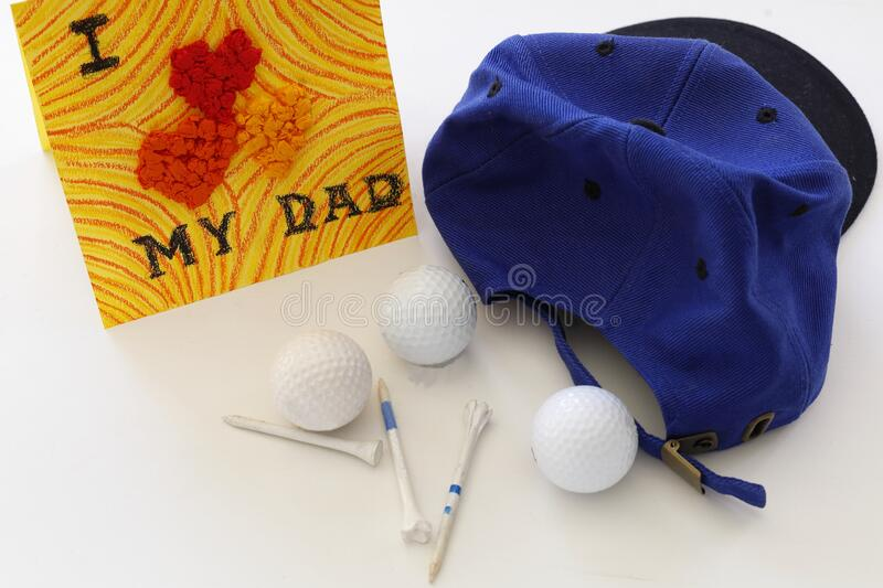 Father`s day: I love my dad greeting card with golf stuff stock photo