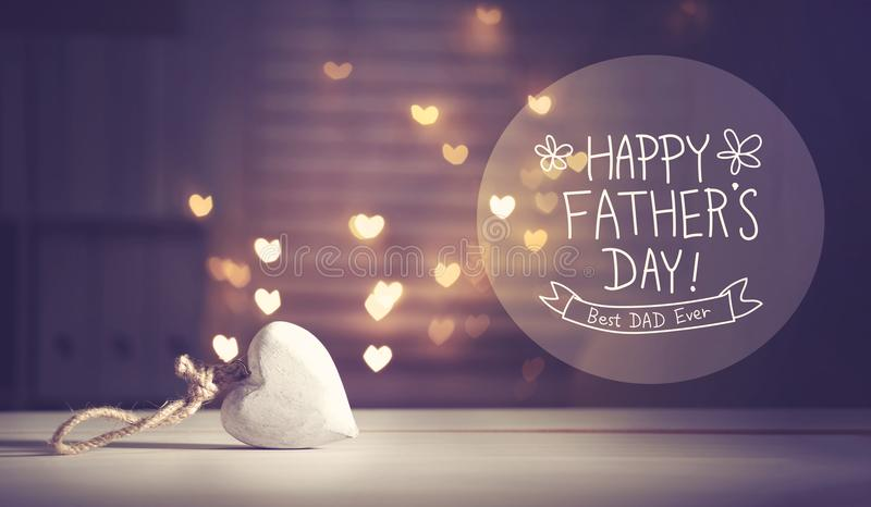 Father`s Day message with a white heart stock photo