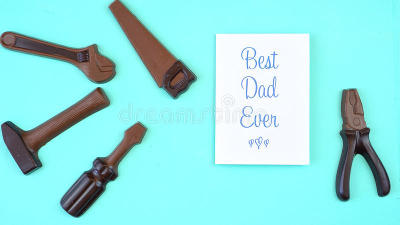 Father`s Day overhead of chocolate tool set with Best Dad Ever greeting card stock photos