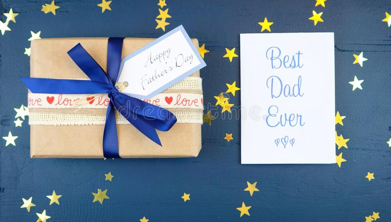Father`s Day overhead with gift and Best Dad Ever card. stock images