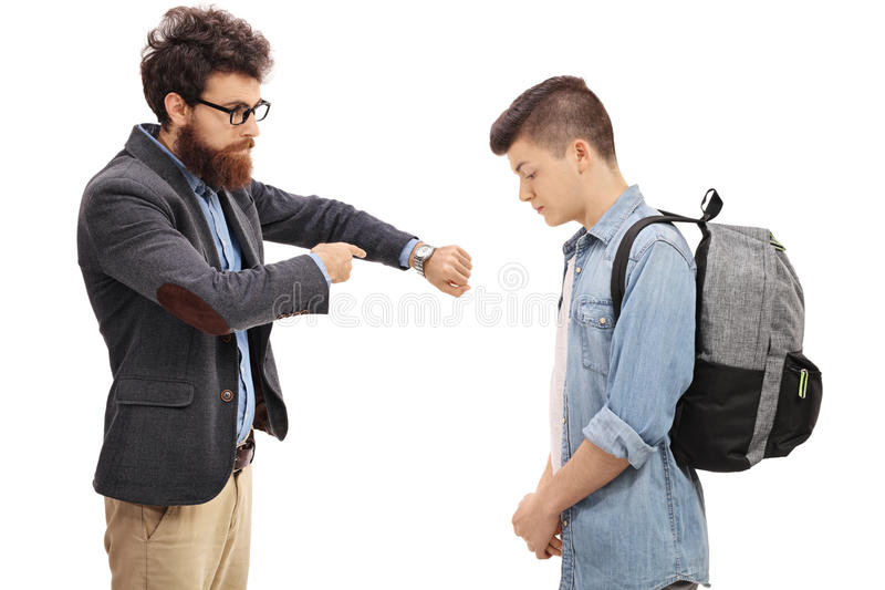Father scolding his son for being late royalty free stock photos