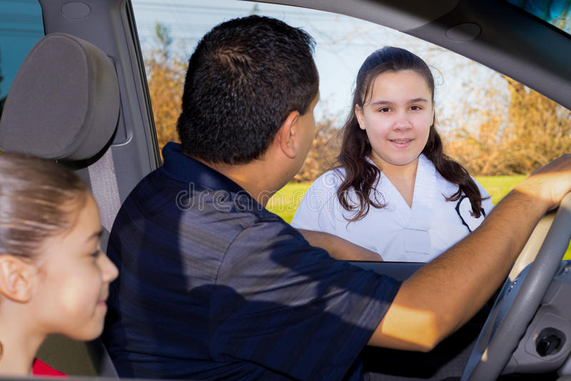 Father Sends Daughter Off To Martial Arts Practice stock photo