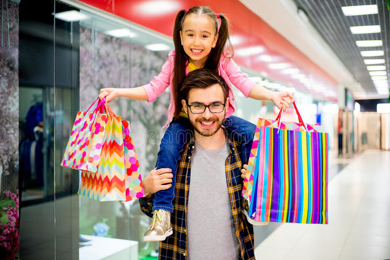 Father is shopping with daughter stock photo