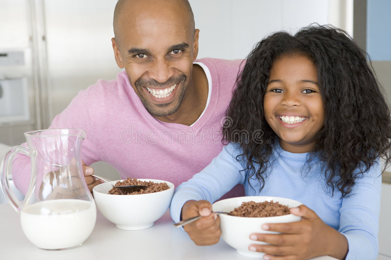 Father Sitting With Daughter Eatting Breakfast royalty free stock images
