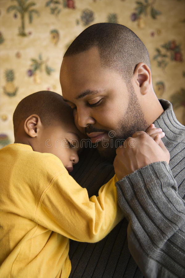 Father Smiling Holding Young Son stock photography