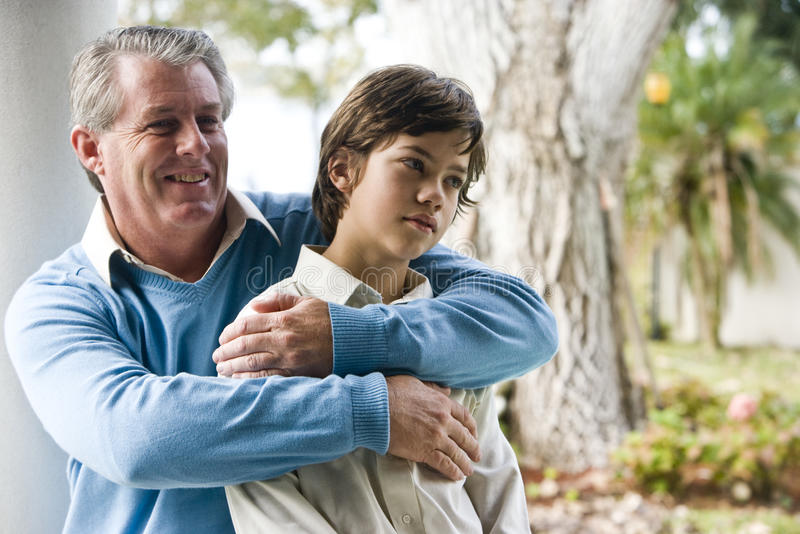 Father and son. Affectionate father and son together outdoors royalty free stock images