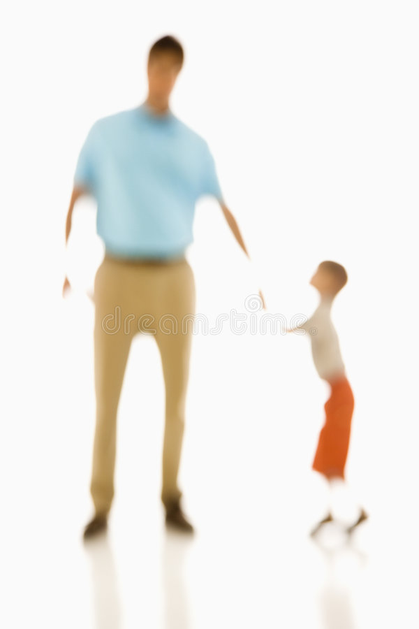 Father and son. Soft focus father holding son's hand