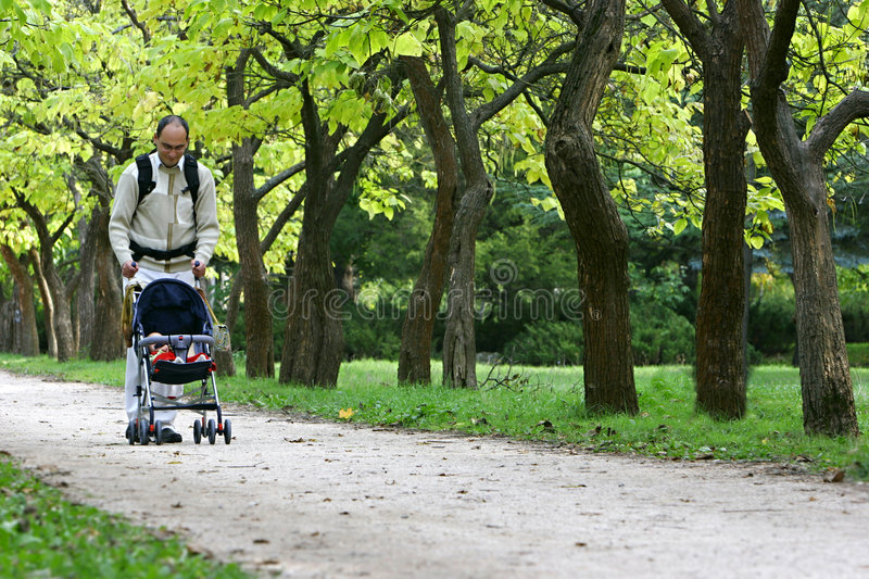 Download Father with son stock image. Image of parent, buggy, park - 3950617