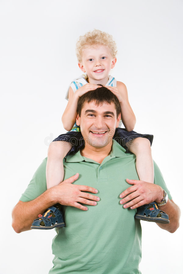 Father and son. Portrait of man holding smiling son on the neck