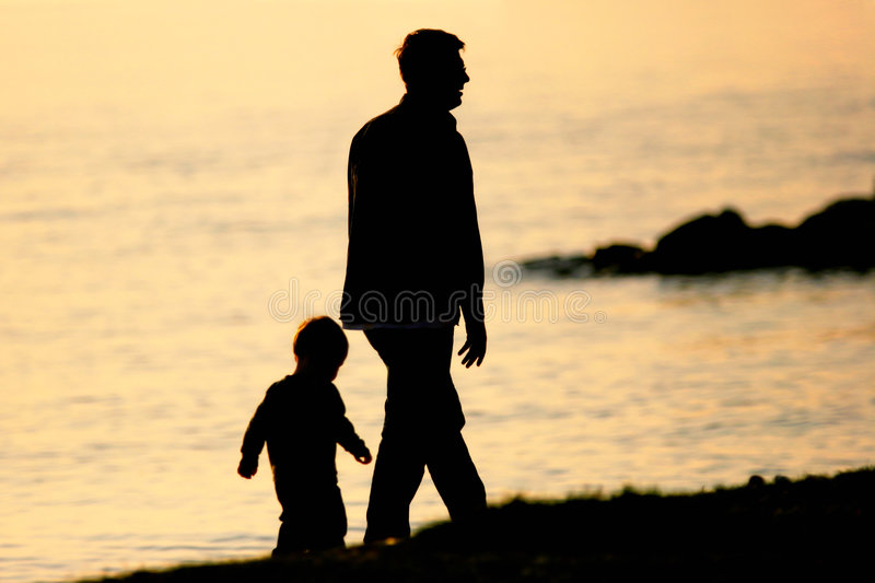 Father and Son. Walking by the sea royalty free stock images