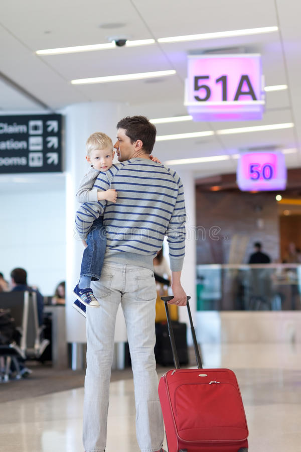 Father and son at the airport. Father and son waiting together at the airport