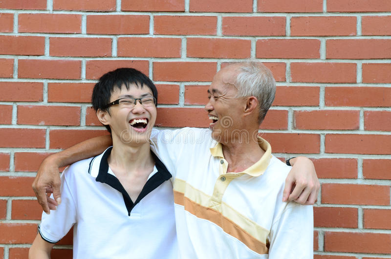 Father and son. Asian father and son laugh happily stock photos