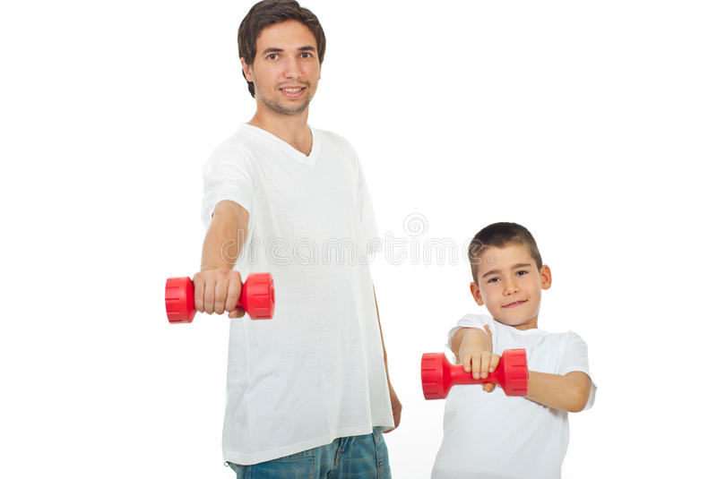 Father and son with barbell stock photos