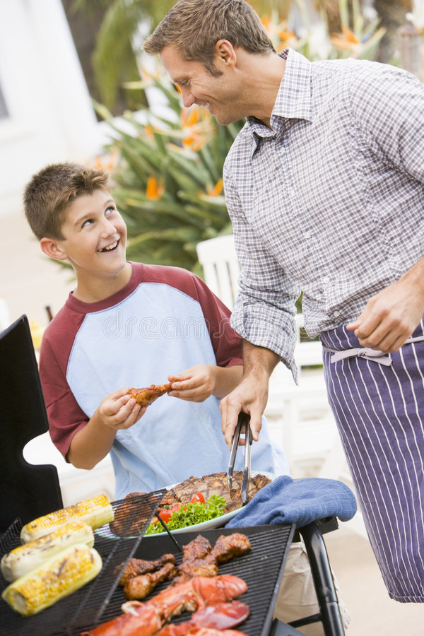 Download Father And Son Barbequing Royalty Free Stock Photo - Image: 7230605