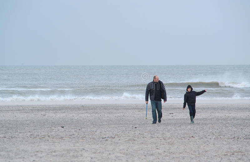 Father and son on the beach royalty free stock photos