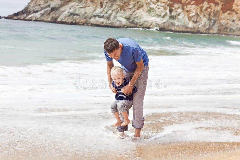 Father and son at the beach royalty free stock image