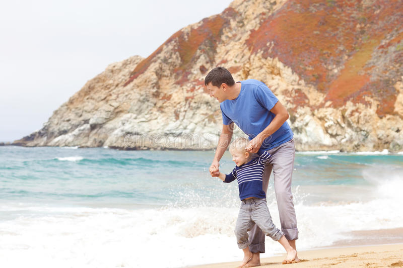 Download Father And Son At The Beach Stock Photo - Image of play, activity: 28441380