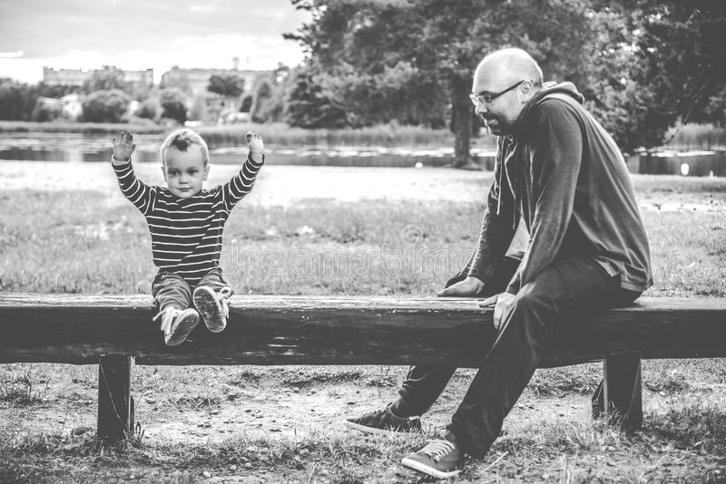 Father and son on the bench stock photography